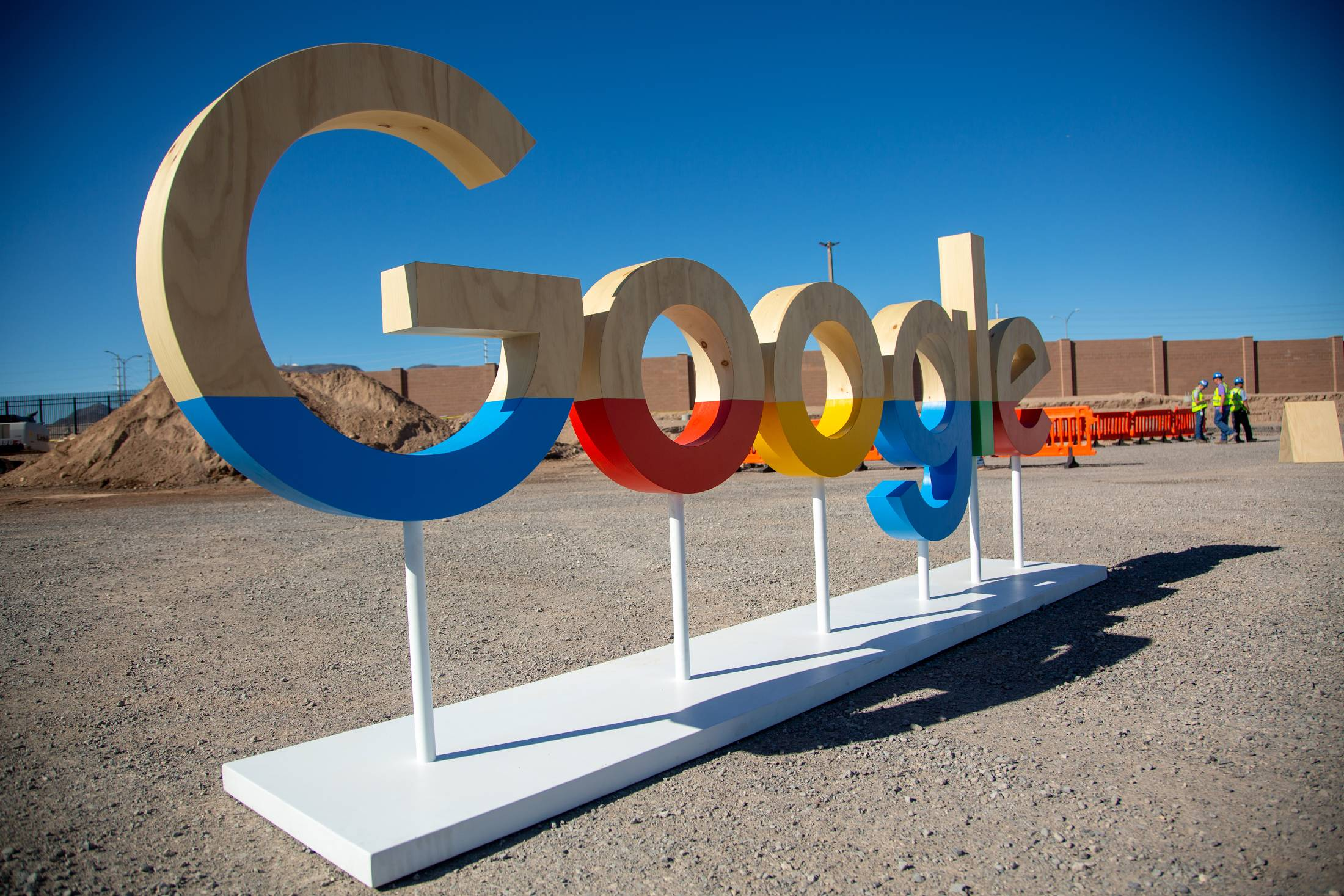 photo of Glum Alphabet execs look up from red-ink ad figures. What will we do, they ask. Ahem, coughs Google Cloud image