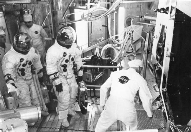 In this image, Apollo 11 backup crew members Fred Haise (left) and Jim Lovell prepare to enter the Lunar Module for an altitude test.