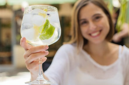 Young woman in a restaurant with gin and tonic