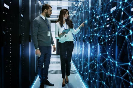 Two IT people working in a data center