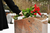 Laying flowers at a grave