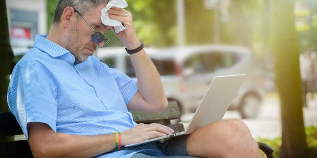 sweaty man uses ultrabook