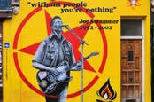 Street art remembrance painting by Emma Harrison and Gary Loveridge of Joe Strummer, punk rock guitarist, songwriter and lead vocalist of Clash, in west London, UK. - Image
