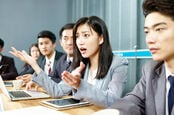 biz types in meeting heated discussion