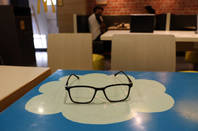 glasses on a cloud desk