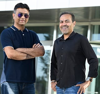 Avinash Lakshman (left) and Sanjay Mirchandani