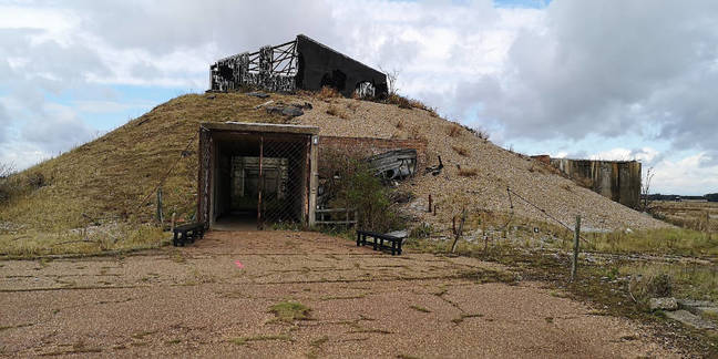 The outside the AWRE Lab 1. Note the shingle piled up to contain explosions