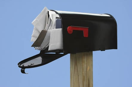 Image of an overstuffed mail box
