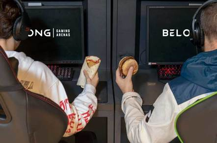 Game players eating a burrito and a burger