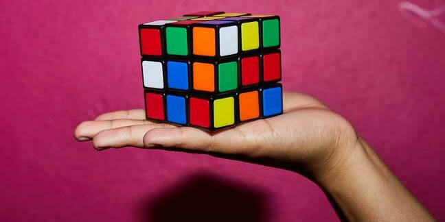 Rubik's Cube on outstretched hand
