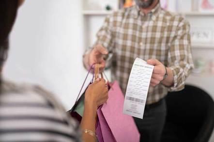 Man handing over a printed till receipt