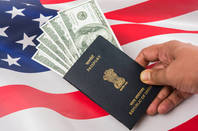 An Indian passport with the US flag