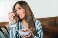 Someone eating porridge