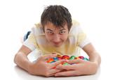 Boy hoarding chocolate eggs