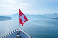 Swiss flag flying on boat