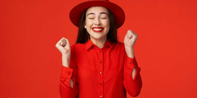 A woman in a red hat looking happy