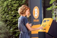 Someone using a Bitcoin ATM