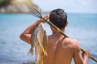 Man with spear and fish