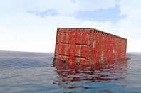 lost shipping container bobs about in the ocean