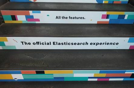 On the stairway at the Elastic event is an ad for the so-called official Elasticsearch experience