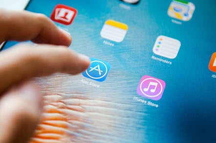 Shutterstock of a woman using the iOS app store
