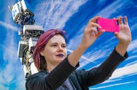 Someone taking a selfie with a 5G mast