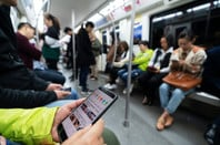 Closeup of a person using a Huawei smartphone on public transport in Chengdu, Sichuan province, China