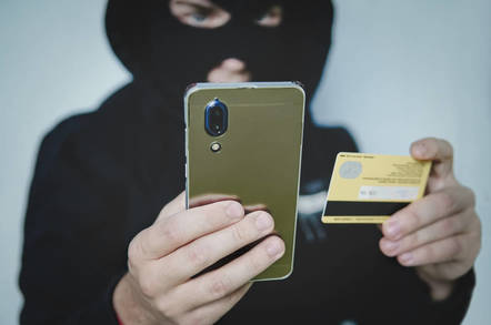 A criminal using a phone for fraud