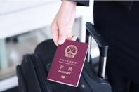Hand holding China passport