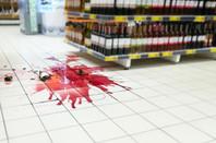Smashed bottle of wine in supermarket