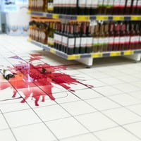Smashed bottle of wine in supermarket
