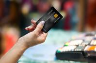 A person presenting a credit card