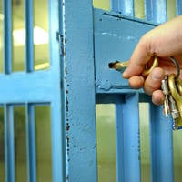 Keys in the door of a jail cell