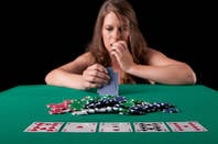 A woman playing poker