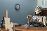 rookie speeling error... tsktsk - robot drinks tea in front of monitor...