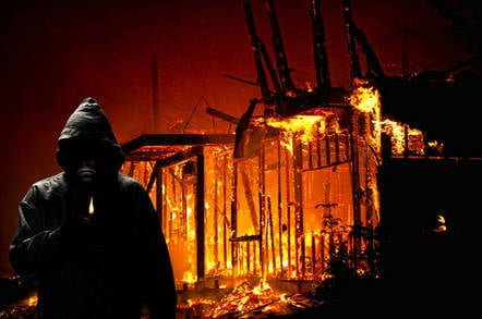 arsonist in front of burning building