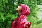 happy red raincoat in rain
