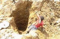 A child mining cobalt in the DRC