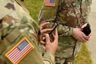 US army privates with cellphones