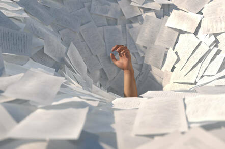 Someone drowning in paperwork
