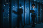 An IT worker walking through a data center