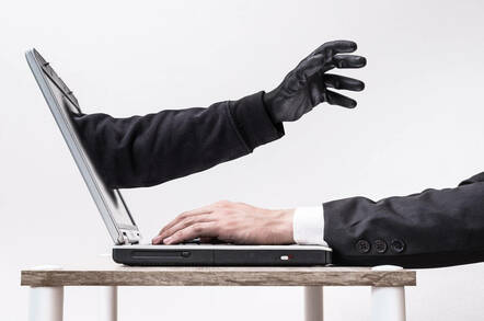 An arm reaching through a screen
