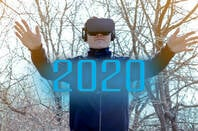A man wearing a VR headset in the year 2020