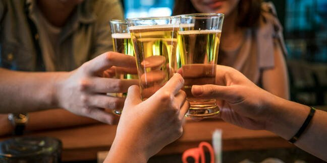 People clinking together beer glasses