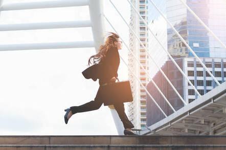 A businesswoman running in a hurry