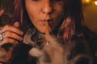 A woman smoking a blunt
