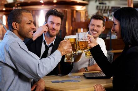 Friends drinking beers after work
