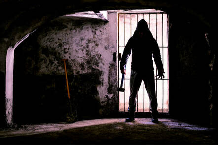 Man holding hammer inside dungeon