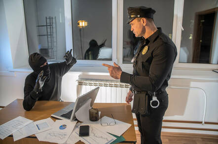 A police officer catches an office burglar