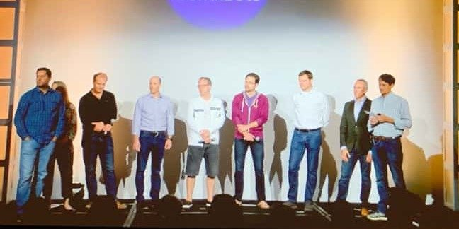 Eight men and a woman at GitLab's Contribute event